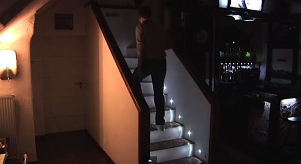 Each Step In The Stairway Lights Up With Led Motion Sensor As Person Ascends